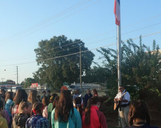 MSP students gather under the flag pole