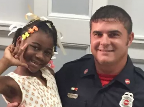 Picture of little girl and fire fighter Ricky Sheppard