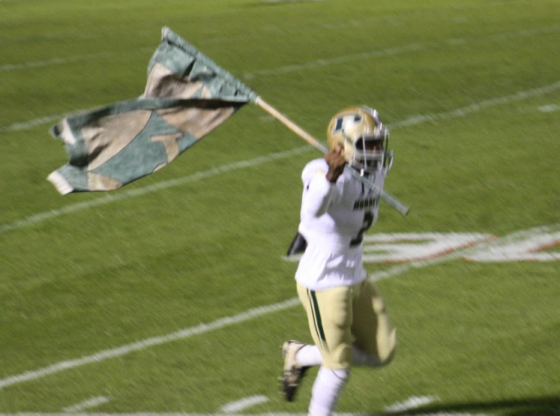 PHS Player Carrying Flag