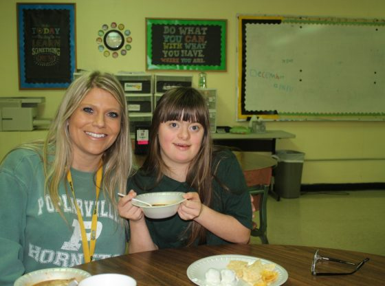 Student and teacher share a bowl of soup.