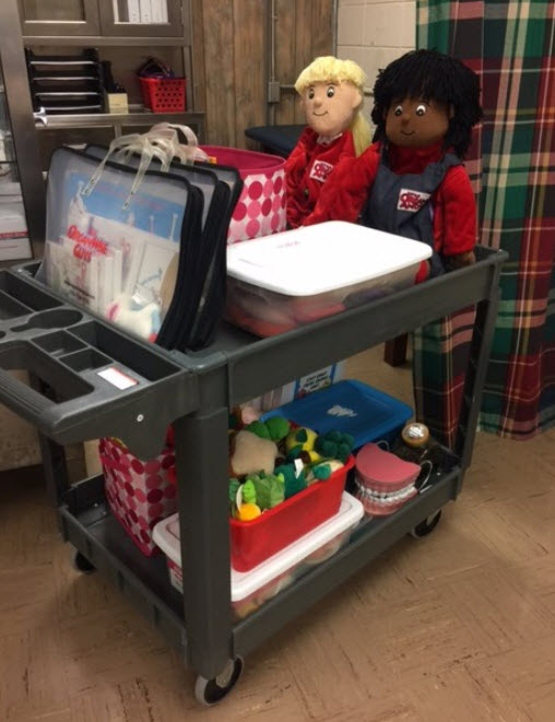 PLE Portable Health Room picture showing dolls, supplies, and other teaching aids