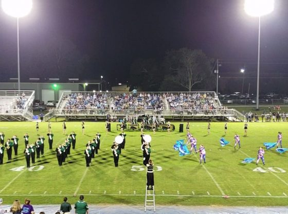 The PHS band performing on the field during halftime.