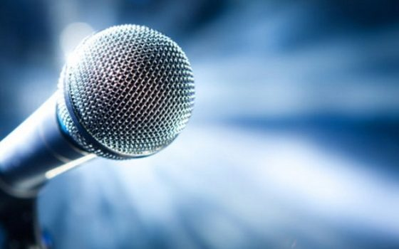 Microphone against a blue background