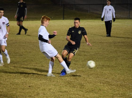 The boys' soccer team faces off against East Central on December 11.