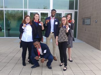 Several members of PHS DECA pose for a photo at District Competition.
