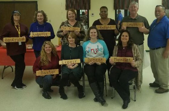 CDC staff holding name plates