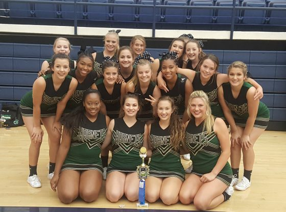 PHS Cheer displaying their trophy from competition.
