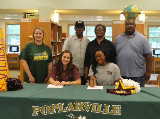Austin Mayfield and Kayla Jordan signing for PRCC.
