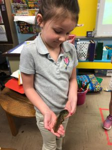 student with tadpole