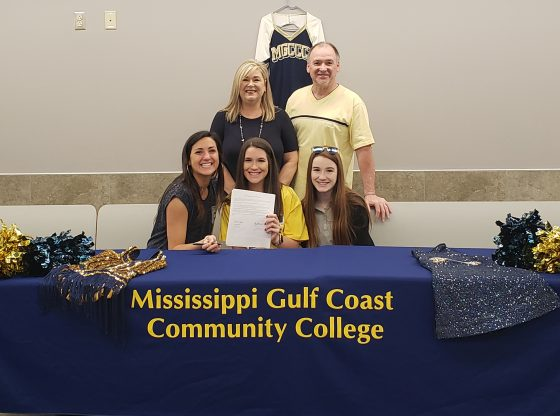 Bailee Crider signing with MGCCC dance team.